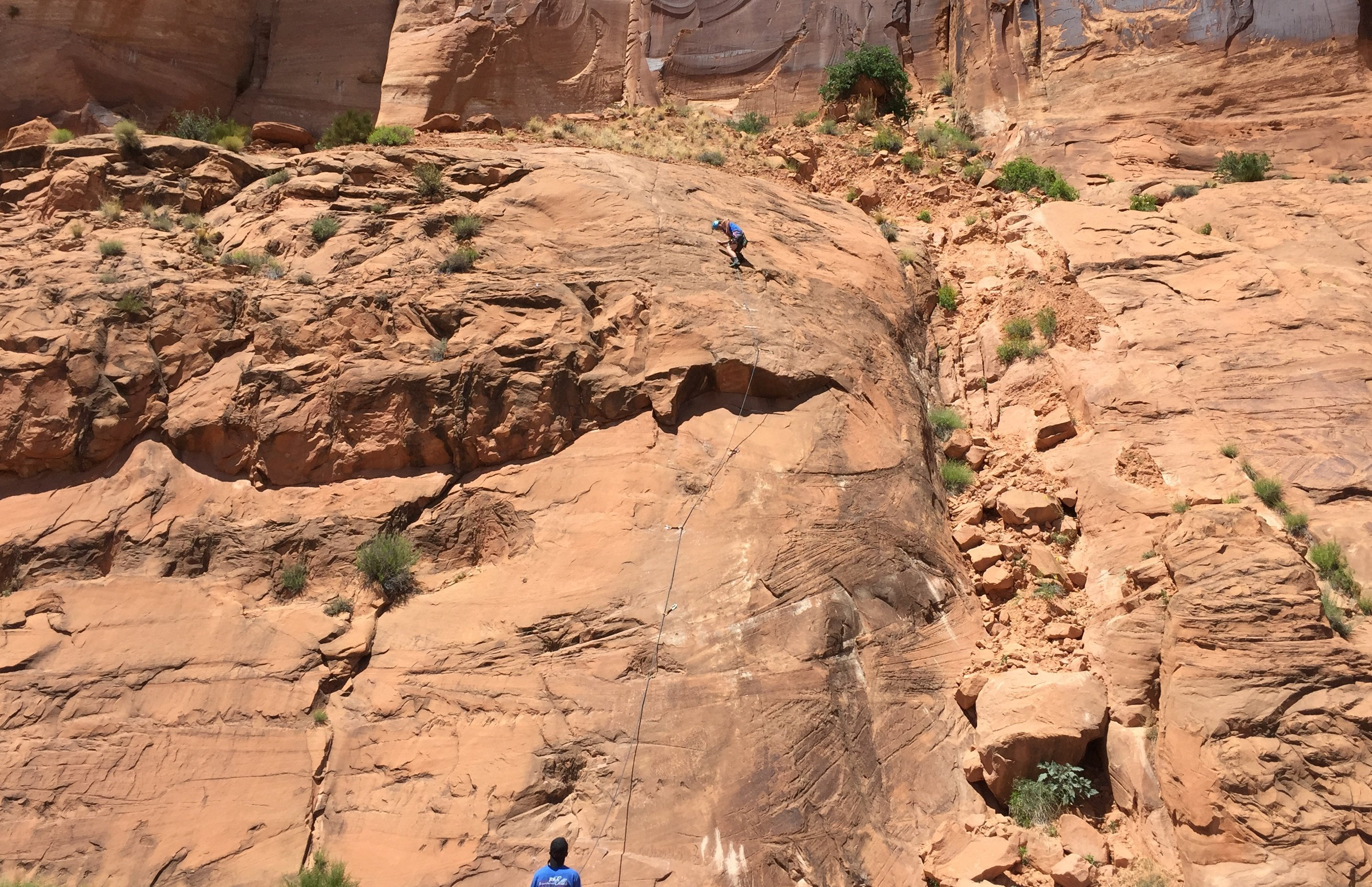 Casey Lead Climbing a Route in Moab
